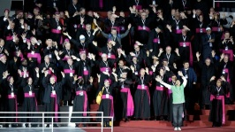Bishops participate in a musical number on stage before Pope Francis arrives for mass in an all-night vigil for those attending World Youth Day, in Rio de Janeiro